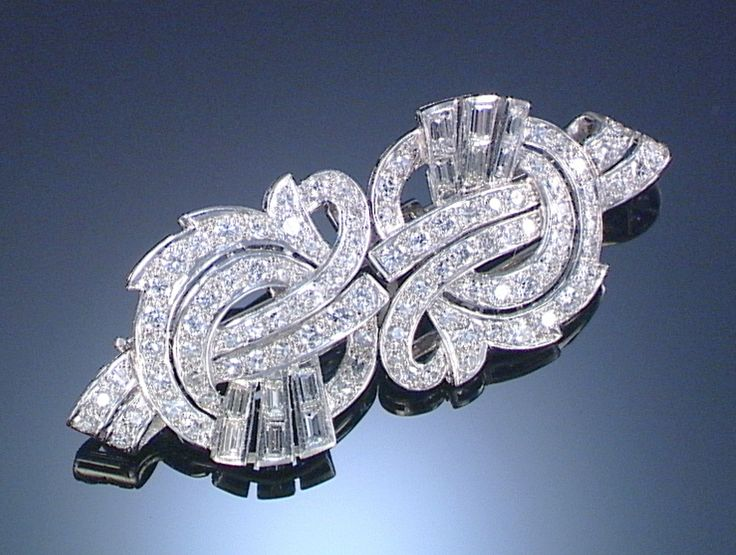 DIAMOND DOUBLE CLIP BROOCH, 1950S Designed as stylised loose ribbons set with ci...