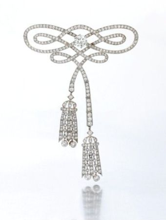 Diamond Corsage Ornament byTiffany & Co, circa 1920, designed as a ribbon bow, s...