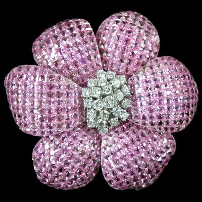 {Pink Sapphire Invisible Flower Pin. Accompanied by by 86.47 carats of Sapphire ...