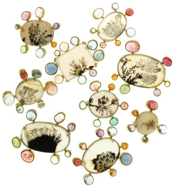 Pins by Judy Geib in gold around stones.
