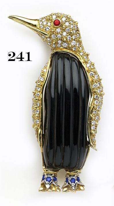 Retro Rare carved onyx, pavé diamond,  ruby and gold penguin brooch.  A. Cipull...