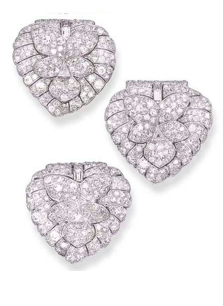 THREE EXQUISITE DIAMOND CLIPS, BY CARTIER  Each designed as an old European-cut ...