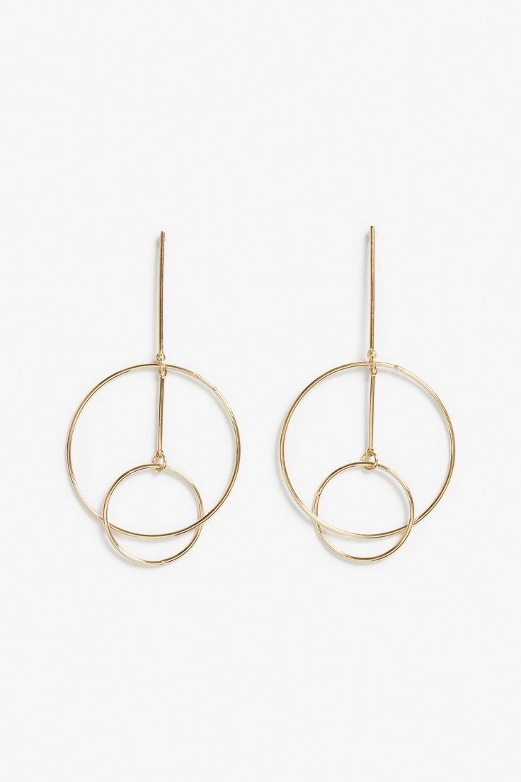 A new take on hoop earrings, these interconnected gold circles give off modern y...