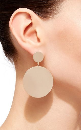 A true object of the designer's minimalist expression, these earrings by **M...