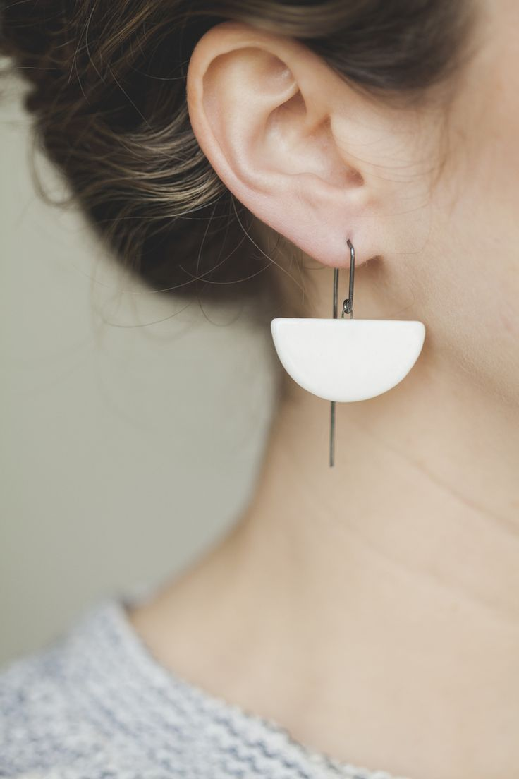 Minimal and elegant ceramic half moon earrings by independent designer Jessica W...