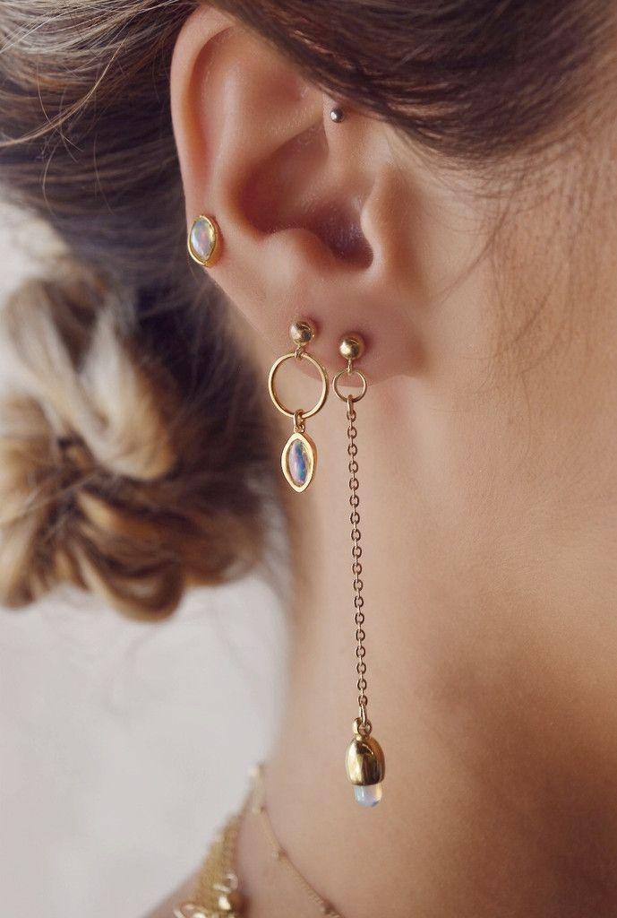 STYLE | Asymmetrical drop earrings with teardrop opals.STONE | Welo Ethiopian Op...