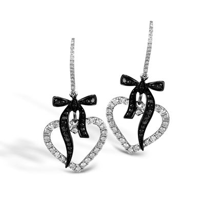 These striking 18K white and black earrings are comprised of .96ctw round white ...