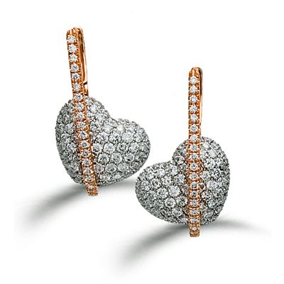 These striking 18K white and rose earrings are comprised of 1.44ctw round white ...