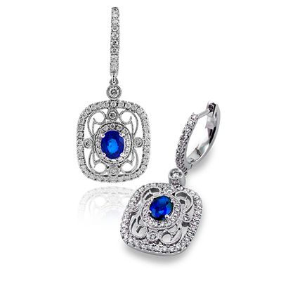 These striking 18K white, yellow and rose earrings are comprised of .70ctw round...