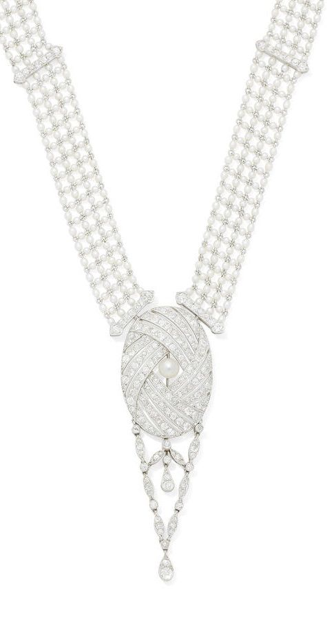 A Belle Epoque seed pearl, pearl and diamond pendant necklace, circa 1910. The w...