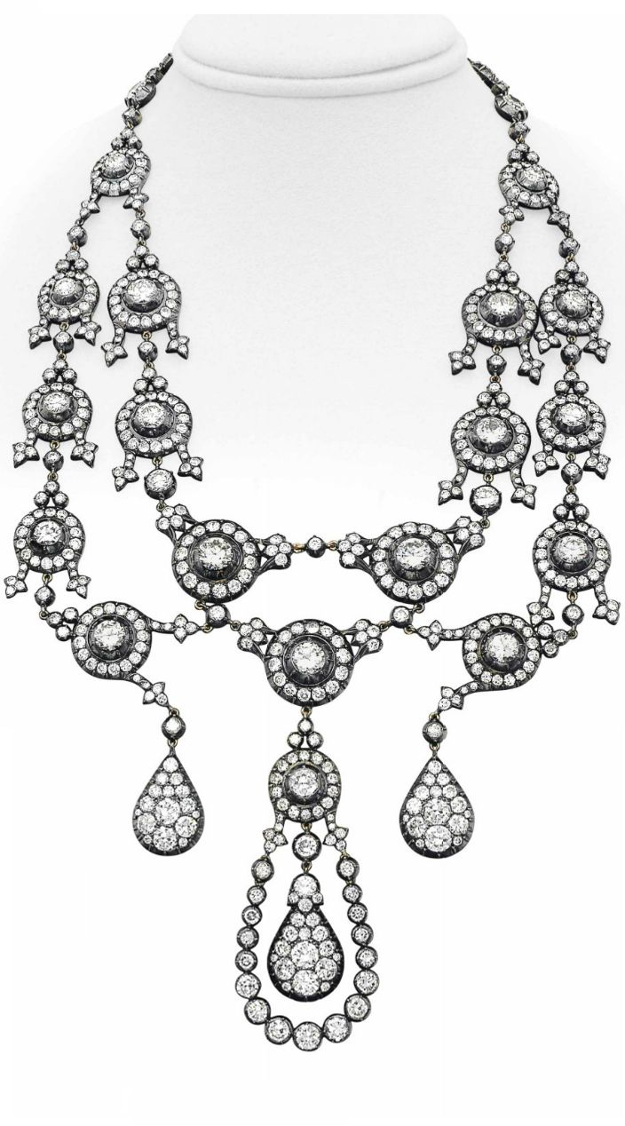 A DIAMOND NECKLACE. Designed as a necklace suspending a two-tiered graduated ser...