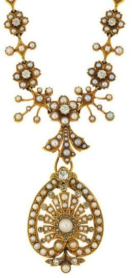A late 19th century half-pearl and diamond pendant necklace  The central half-pe...