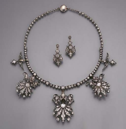 AN ANTIQUE DIAMOND NECKLACE/TIARA, The old-cut diamond collet line suspending th...