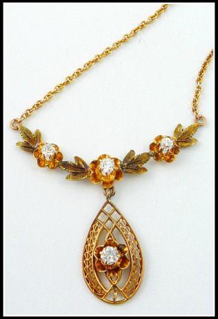 An antique diamond and 10 karat gold necklace.