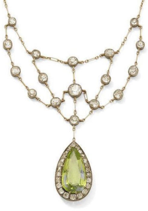 An antique peridot and diamond necklace, circa 1900. The pear-shaped peridot wit...