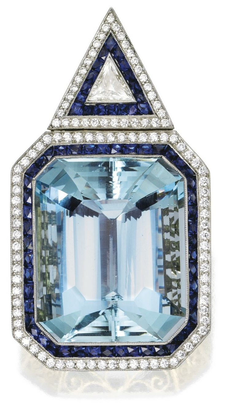 Contemporary aquamarine, sapphire, and diamond pendant.  It's centered by a ...
