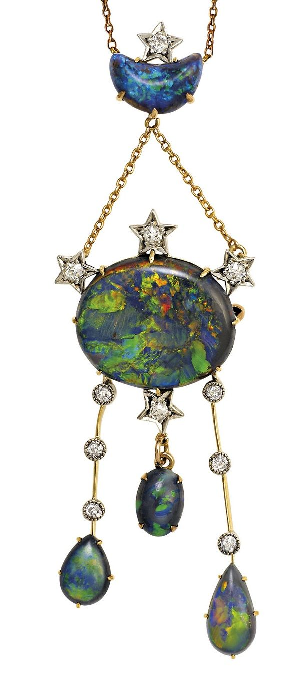 Opal and diamond necklace, circa 1910. Of celestial design, the half moon-shaped...