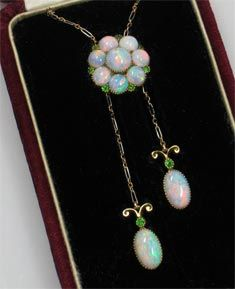 Opal, green garnet and 18 karat gold necklace, circa 1890.