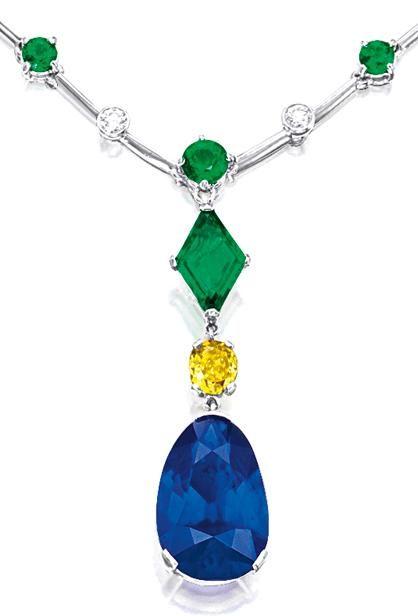 SAPPHIRE, EMERALD, FANCY DEEP YELLOW DIAMOND AND DIAMOND NECKLACE.    Suspending...