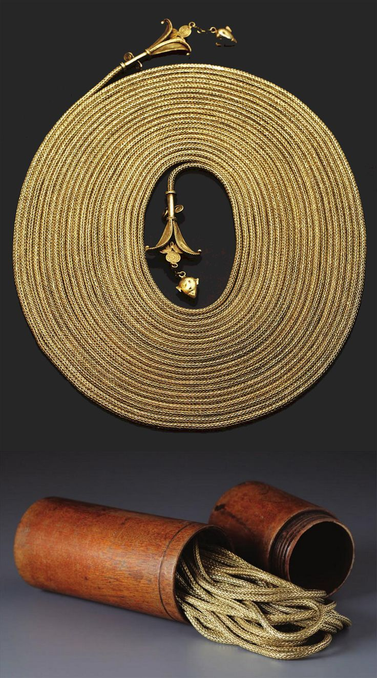 ndonesia ~ East Sumba | Ceremonial woven chains with container (kanatar); gold, ...