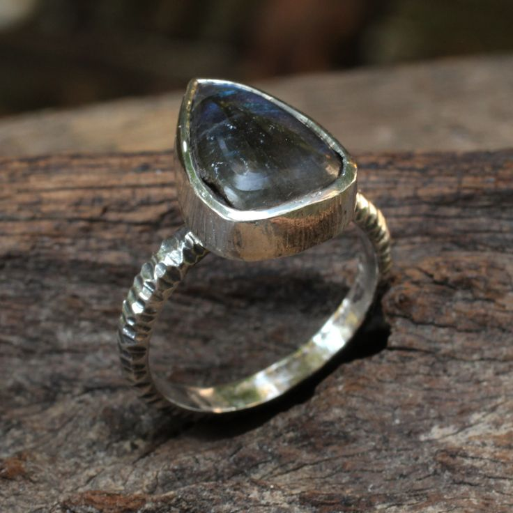 Small teardrop labradorite ring in hand crafted stelring silver band.