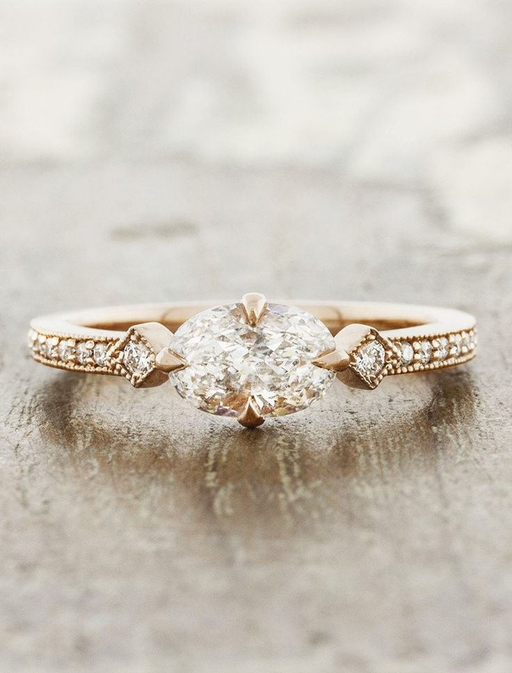 The Charleen is an art deco inspired engagement ring - with an oval diamond in a...