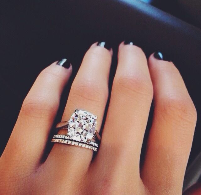 stunning round solitaire engagement ring with diamond wedding bands