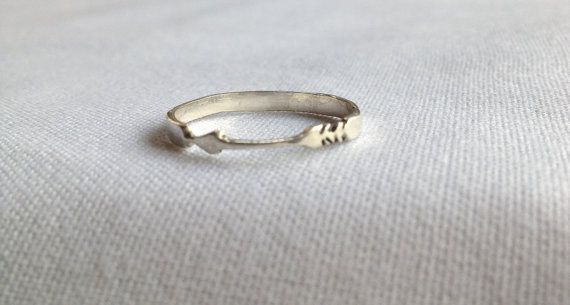 Hand-carved Aim For Love Ring