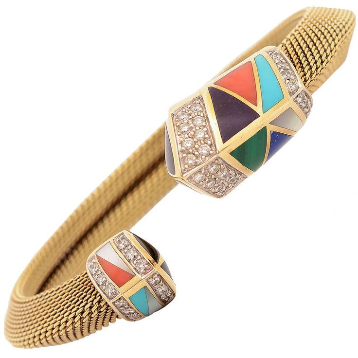 Fourteen karat gold bracelet by Asch Grossbardt with chevron shaped tips of diff...