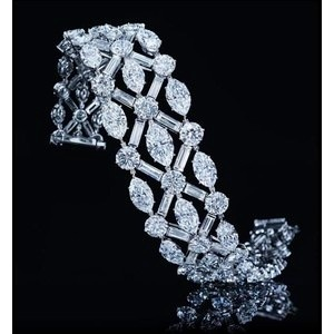 Harry Winston Diamond bracelet. Great skin is the best accessory.  For natural s...