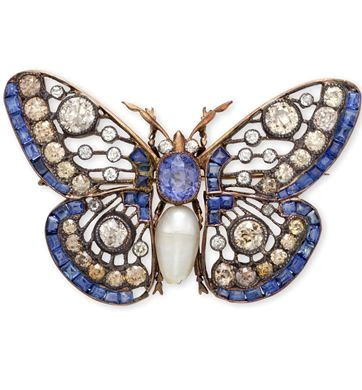 A SAPPHIRE, DIAMOND AND CULTURED PEARL BUTTERFLY BROOCH. The openwork butterfly ...