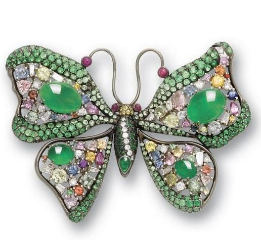 A jadeite and multi gem set brooch Designed as a butterfly, set with cabochon ja...