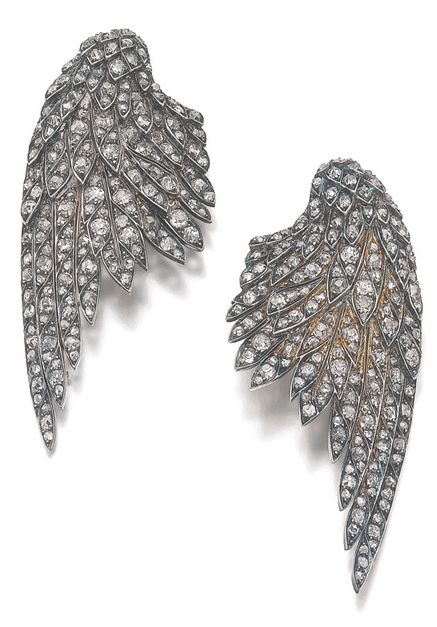 A pair of diamond clips, early 20th century. The clips in the form of wings set ...