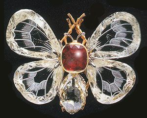 Boucheron diamond and ruby butterfly brooch.  The wings are made of engraved dia...