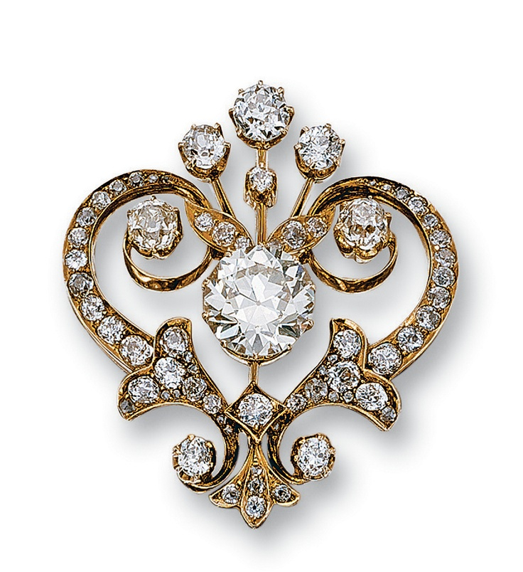 DIAMOND BROOCH,  LATE 19TH CENTURY.  Designed as a flowery heart set at the cent...