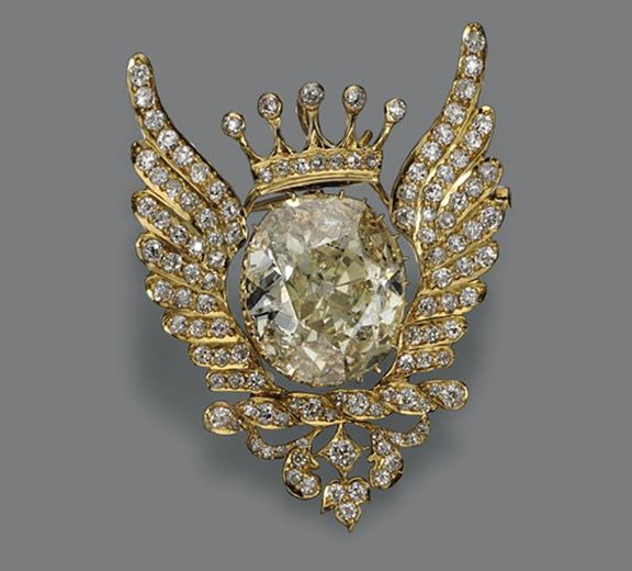 DIAMOND PENDANT-BROOCH Set in the center with a cushion-shaped diamond weighing ...