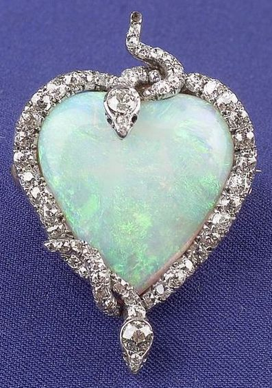 Edwardian Platinum, Opal, and Diamond Snake Pendant/Brooch, designed as a heart-...