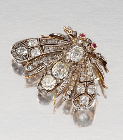 RUBY AND DIAMOND BROOCH/PENDANT, LATE 19TH CENTURY Designed as a moth, its wings...