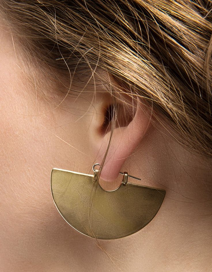From Tiro Tiro, a pair of polished half disk earrings in brass