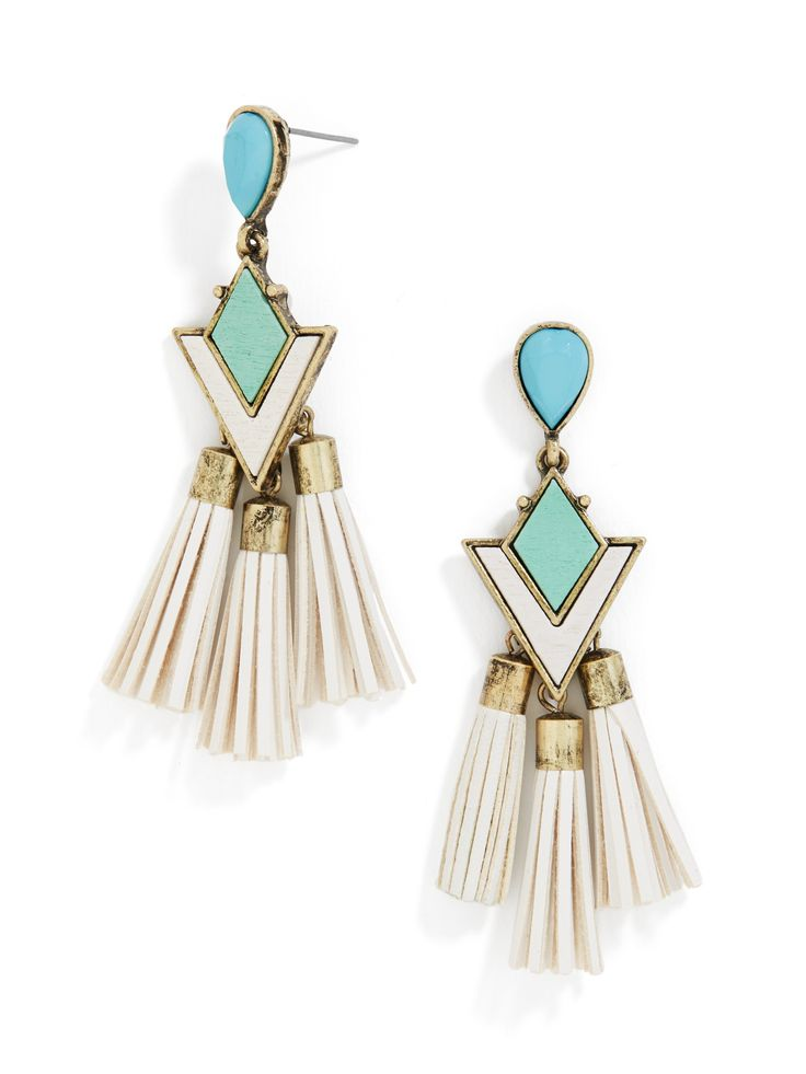 These futuristic statement earrings feature a delightfully '80s color palett...