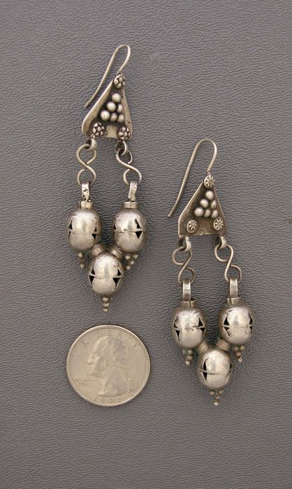 Very old lightweight silver earrings from the Uzbeks, who inhabited what is now ...