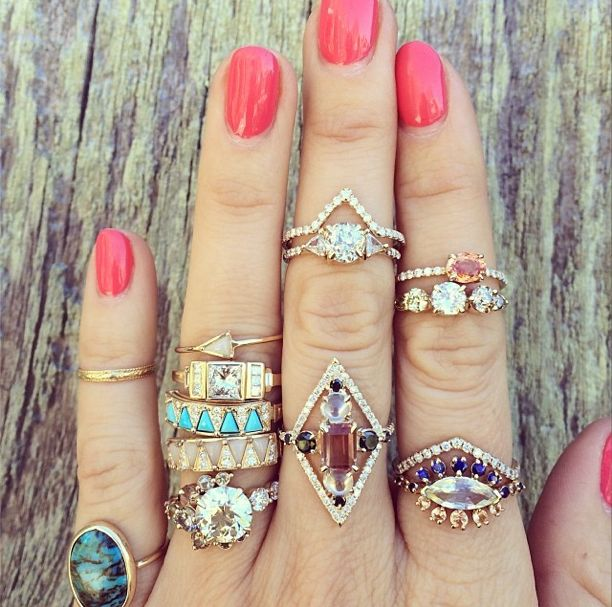 I love the two rings on the middle finger. A different twist on wedding band/eng...
