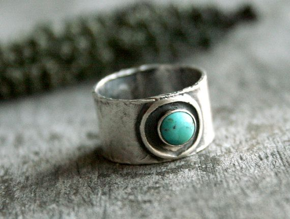 The Desert Oasis ring is constructed from rustic sterling silver and a beautiful...