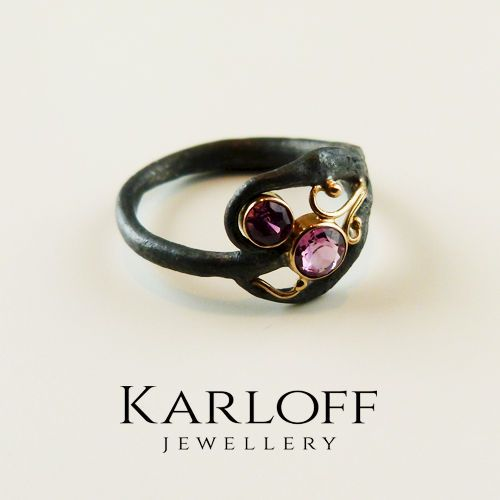 silver and golden ring with tourmaline