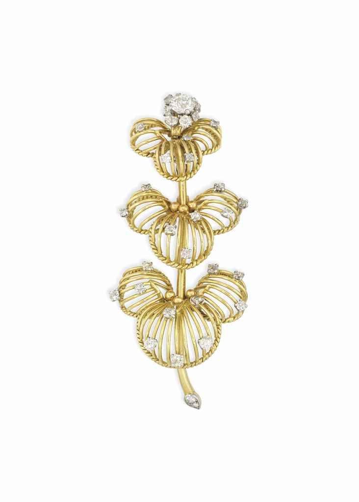 A DIAMOND-SET BROOCH, BY CARTIER Modelled as stylised flowerhead, the nine gradu...