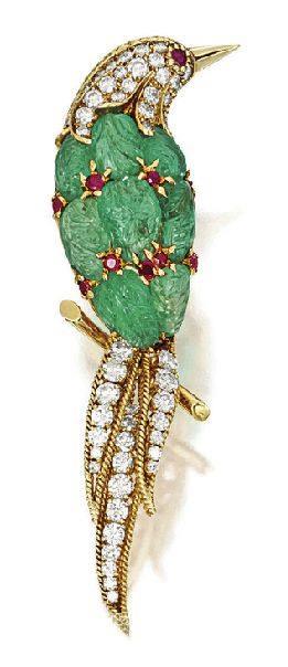 A carved emerald, ruby, and diamond bird brooch by Van Cleef & Arpels, New York,...