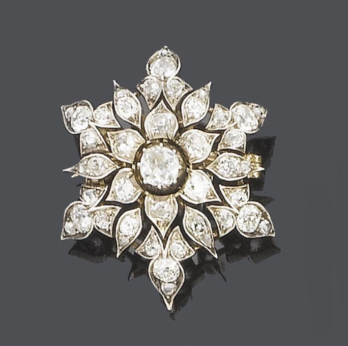 A late 19th century diamond brooch/pendant, circa 1880  The pierced flowerhead s...