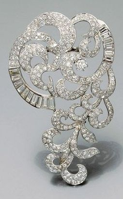 A magnificent platinum, white gold and diamond brooch, circa 1935. Designed as s...