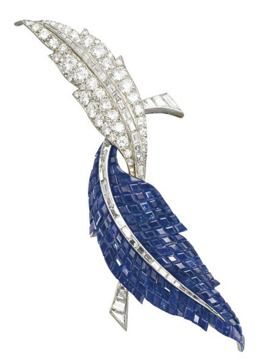 AN ELEGANT 'MYSTERY SET' SAPPHIRE AND DIAMOND 'DEUX FEUILLES' BR...