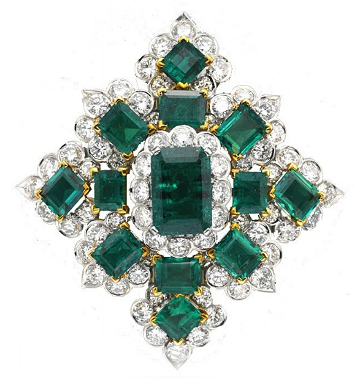 AN EMERALD AND DIAMOND BROOCH, BY VAN CLEEF & ARPELS   Designed as a navette-sha...